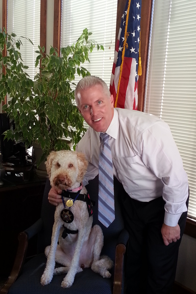 District Attorney Jeff Reisig with Victim Services' Aloha